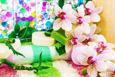 Spa concept with sea salt, soap, bamboo, orchid, towel, balls photo