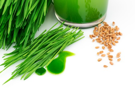 Wheatgrass juice with sprouted wheat and wheat isolated on white Stock Photo