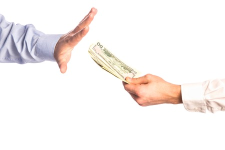 business deal: Male hands rejection bribe isolated on white background