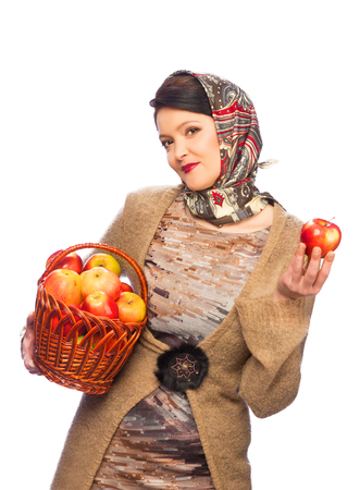 Woman with autumn apples in basket isolated on white background photo