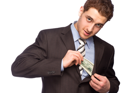 bosom: Lucky man putting money in his bosom isolated on white background