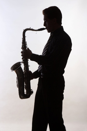 amorous: Saxophone amorous player silhouette on grey background