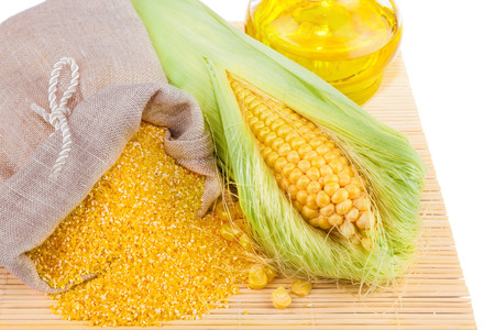 maize flour: Composition from corn, maize flour and corn oil on the mat isolated on white background Stock Photo