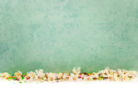 Abstract spring border background with blossom and candies Stock Photo