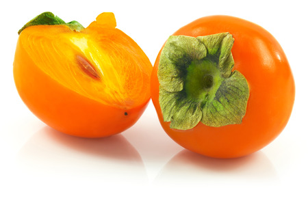 Macro view of ripe persimmon isolated on white background photo