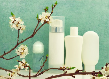 Spring composition with body care products and spring blossom