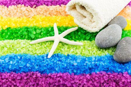 Color sea salt rainbow with sea star, stones and bath towel