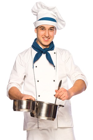 Portrait of smiling cook chef with kitchenware isolated on white background photo