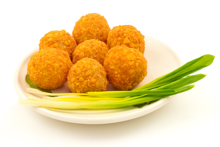 eating chicken: Crispy cheese balls with green onion on the plate isolated on white background
