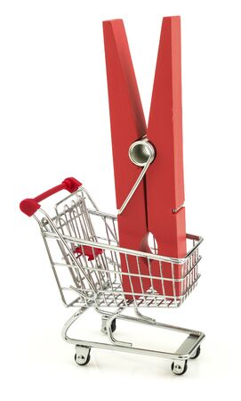 clothespeg: Business concept with clothes peg in the shopping cart isolated on white background