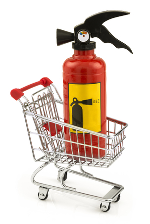 emergency cart: Extinguisher standing in the shopping cart isolated on white background
