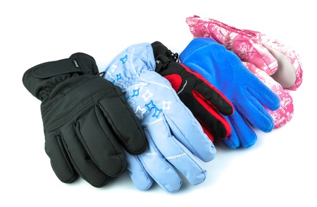 Collection of multicolor ski gloves varied in size isolated on white background