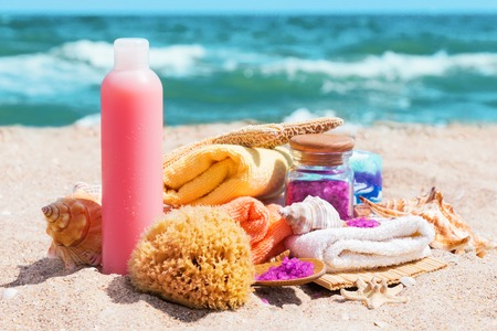 Macro view of spa beauty products: towels, soap, shells, sea salt on the sea coast