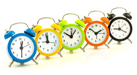 align: Colorful alarm clocks, align isolated on white background