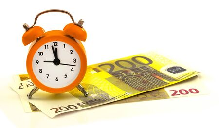 regress: Alarm clock with paper money, 200 euro isolated on white background