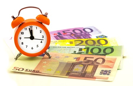 regress: Alarm clock with paper euro money 50, 100, 200, 500 isolated on white background