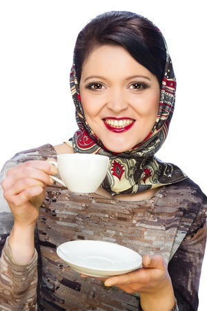 Smiling woman with cup of coffee or tea isolated on white background Stock Photo