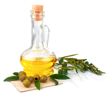Glass bottle of olive oil with olives and leaves on the mat isolated on white background Stock Photo