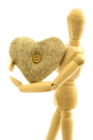 woolen: Macro view of wooden male person with knitted woolen heart with button isolated on white background Stock Photo