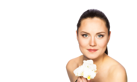 Portrait of beautiful woman with orchid isolated on white background