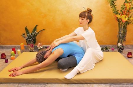 Women practicing physical energy flexibility exercise indoor Reklamní fotografie
