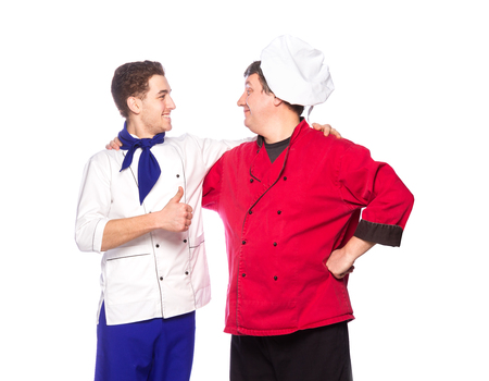 Team of two men, chefs, cooks isolated on white background