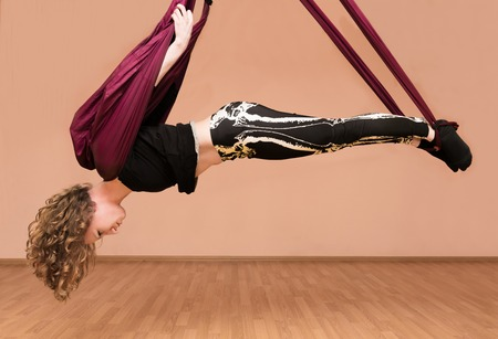Woman making aerial yoga exercises with hammock, fly yoga Reklamní fotografie