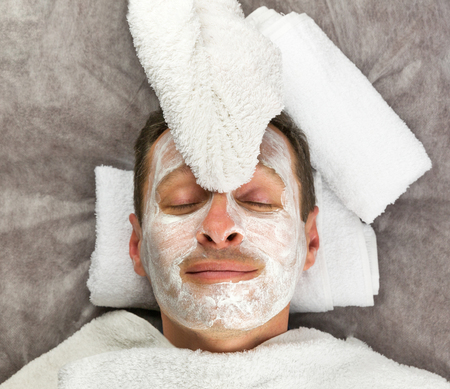 Face of man with cream mask, towels, beauty, spa