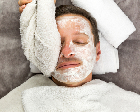 Macro view of face of man with cream mask, towels, beauty, spa Reklamní fotografie
