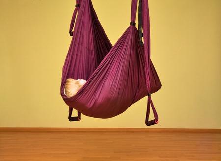 Little girl making aerial yoga exercises, indoor, aerial yoga