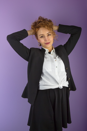 Businesswoman in suit with curly hair