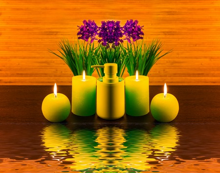 Abstract spa concept with flower, candle, water, spa product and reflection