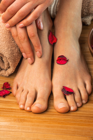 Beautiful female feet and hands, spa salon, pedicure and manicure procedure