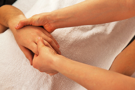 Hand massage with white towel