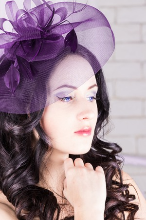 Beautiful girl with purple hat Reklamní fotografie - 74887292