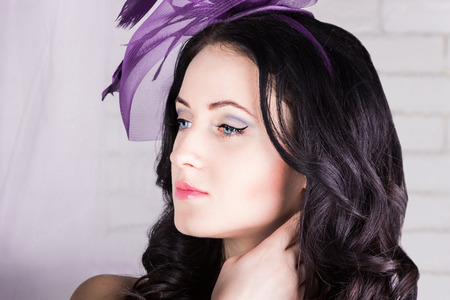 Beautiful girl with purple hat
