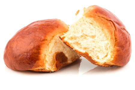 Fresh baked tasty sweet brioches, buns, loaves, bread isolated on white background Foto de archivo