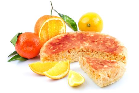 Tasty sweet pie homemade with orange, lemon, tangerine, mandarin, mandarine and slices of fresh fruit with green leaves isolated on white background Reklamní fotografie