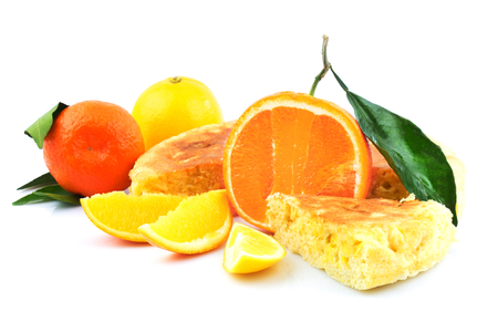 Fresh fruit, orange, lemon, tangerine, mandarin, mandarine with green leaves and tasty sweet slices of appetizing pie isolated on white background Reklamní fotografie