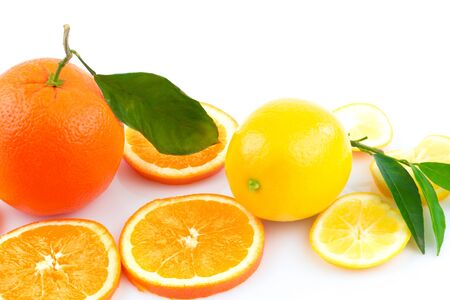 Macro view of various fresh citrus fruits and slices isolated on white background