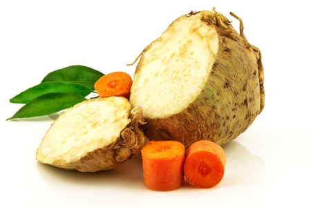 Celery root and carrot mix vegetables with green fresh greenery isolated on white background