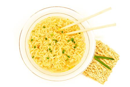 Fastfood soup in the plate with green onion, chopsticks and raw ramen instant noodle uncooked isolated on white background Reklamní fotografie