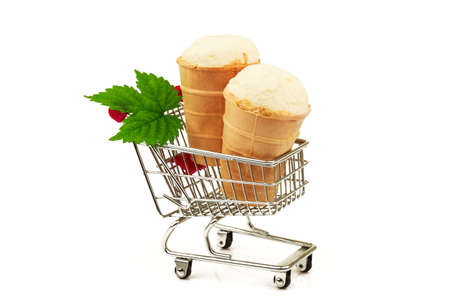 Two tasty milky ice cream in waffle with fresh green leaf in metallic shopping trolley isolated on white background 스톡 콘텐츠