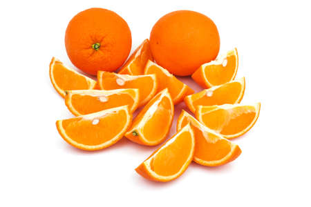 Two whole oranges with slices isolated on white background Reklamní fotografie