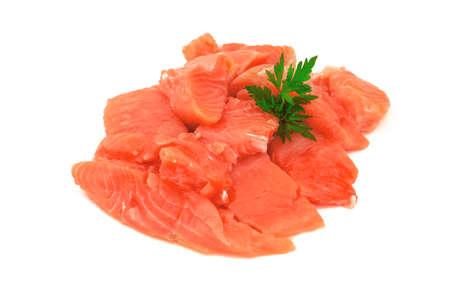 Pieces of red salmon fish with fresh parsley herbs isolated on white background