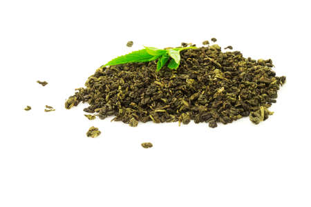 Heap of tea with fresh green leaf plant isolated on white background