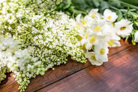 floristry: White flowers on a wooden table.Gardening and floristry, preparation of flowers to create a bouquet. Stock Photo