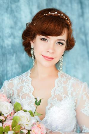 Closeup portrait of young gorgeous bride. The boudoir dress (negligee). Stock Photo
