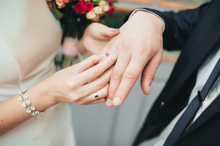 wearing wedding ring ceremony tradition. wedding concept.