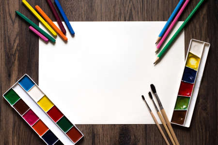 brushes, paints, pencils on a white background. Archivio Fotografico